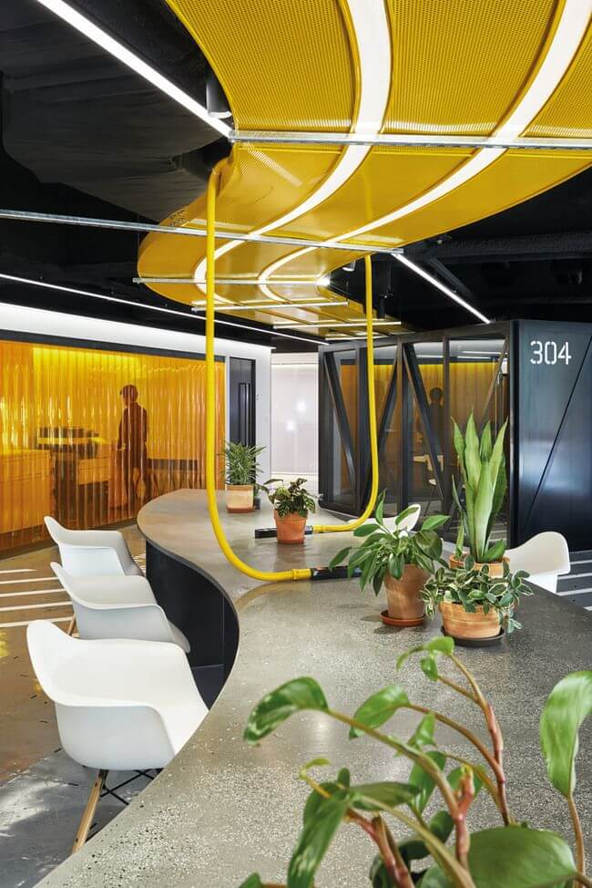 Illuminating Yellow and Ulitmate Gray are at home in an office setting.